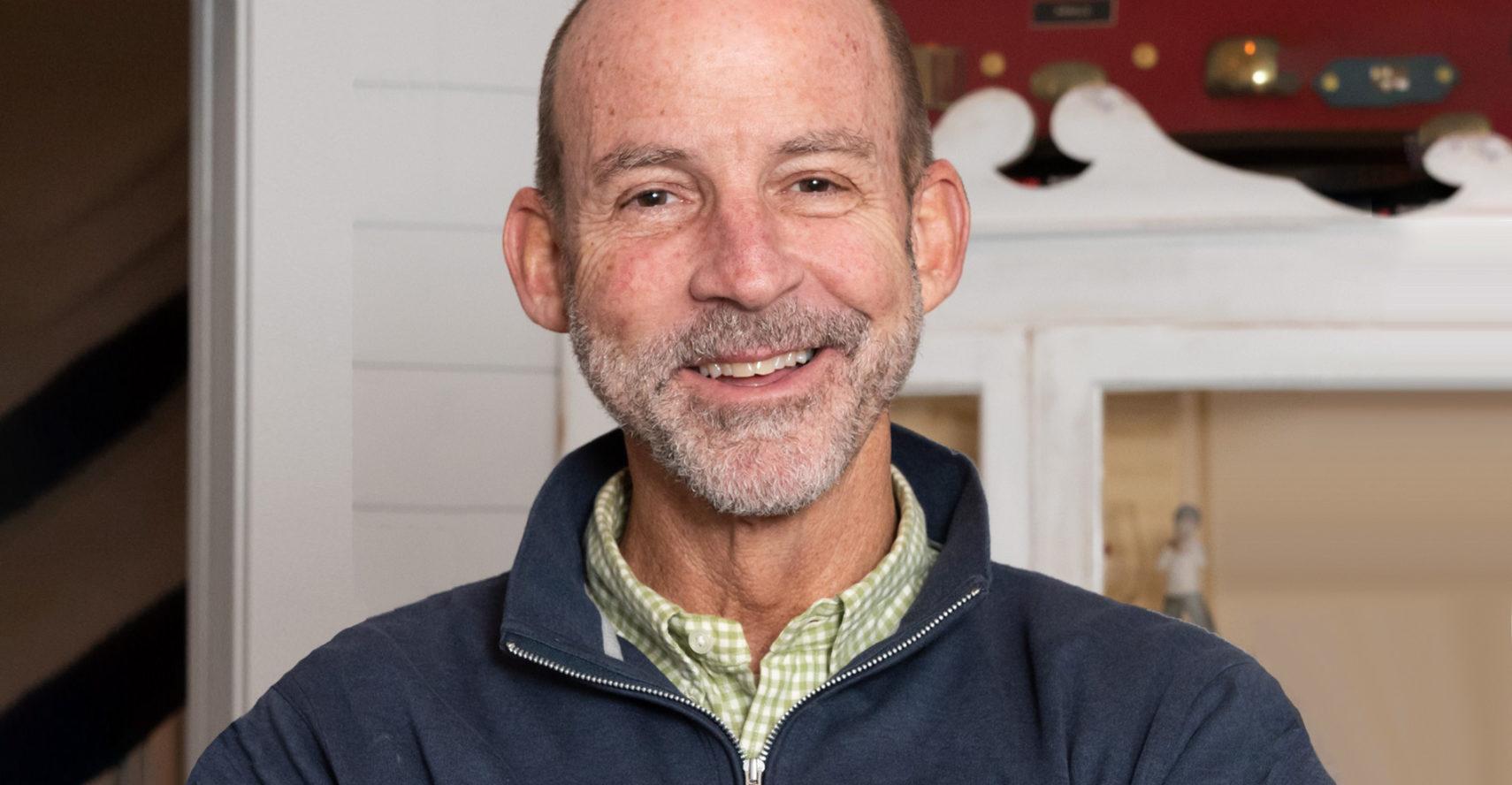 Man smiling at camera | Tony Arnold